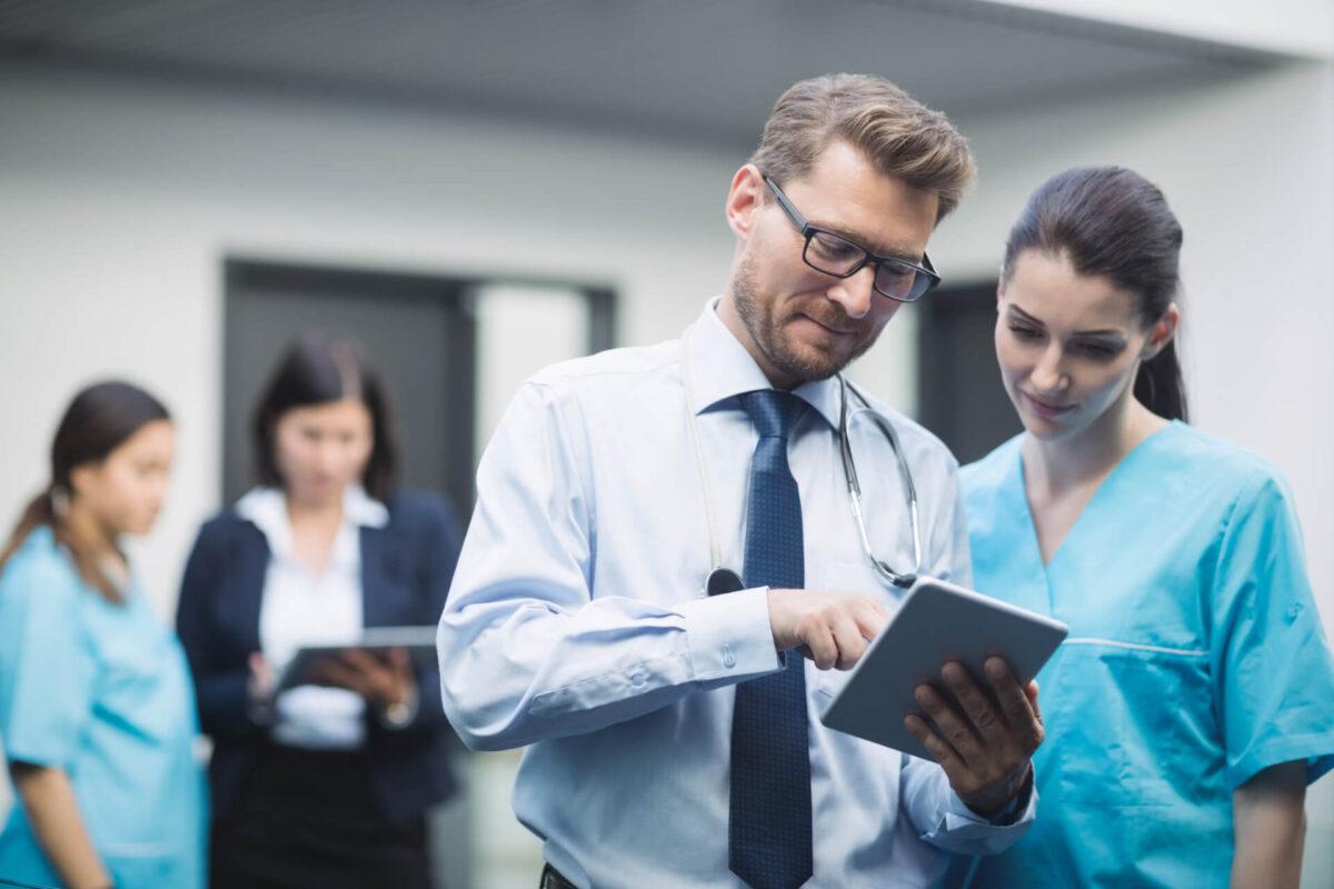 doctor-nurse-discussing-digital-tablet[1]
